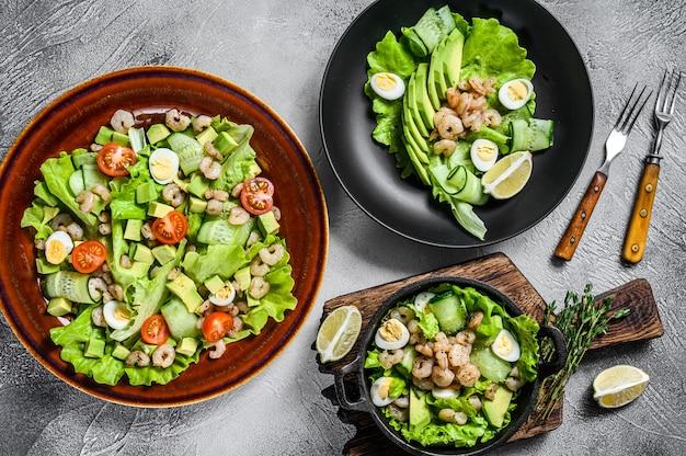 Set of seafood avocado, shrimps, prawns salads. white background. top view.