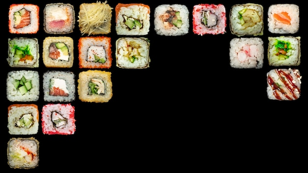 Set of seafood - isolated rolls on black background.