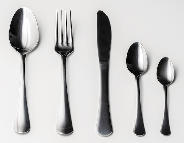 Set of silver cutlery on a white background
