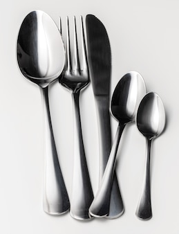 Set of silver cutlery on a white surface