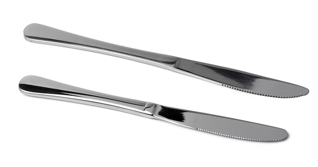 Set of silver dining knives isolated on white