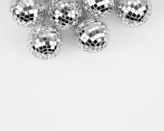 Set of silver disco globes with copy space