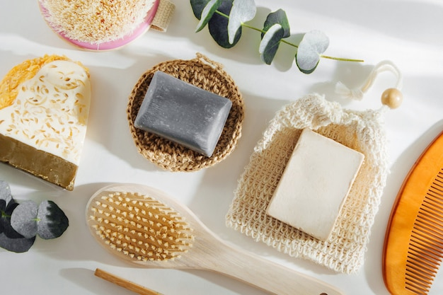 Set of soap eco bag, bamboo toothbrush, natural brush eco cosmetics products and tools. zero waste, plastic free. sustainable lifestyle concept.