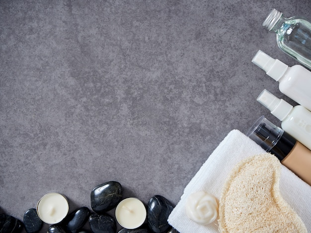 Set of spa accessories on gray marble background.