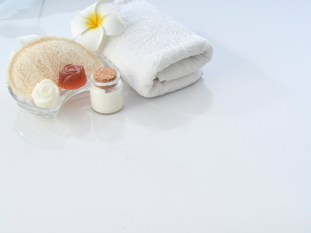 Set of spa accessories on a white table
