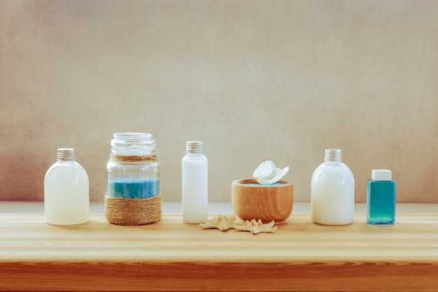 A set of spa products on a wooden shelf
