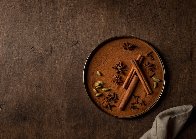 Set of spices, cinnamon, cardamom, star anise, cloves wooden surface
