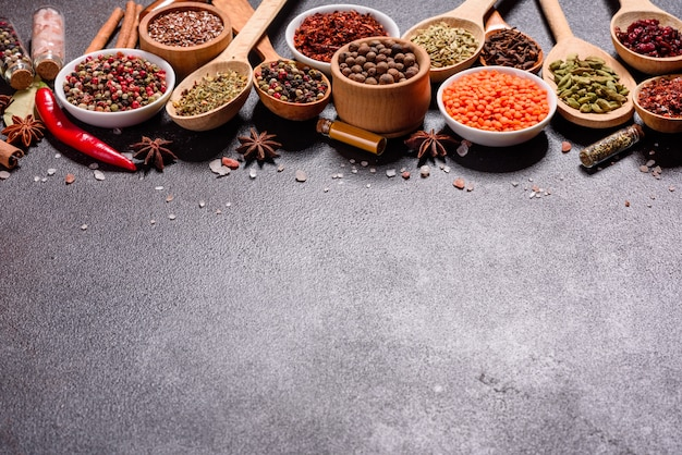A set of spices and herbs. indian cuisine. pepper, salt, paprika, basil and other. top view.