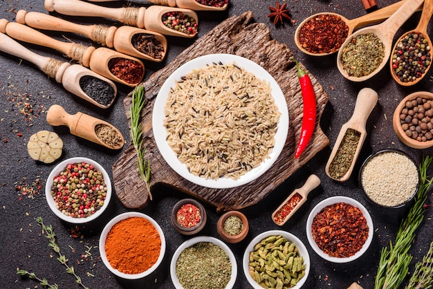 A set of spices and herbs. indian cuisine. pepper, salt, paprika, basil. top view.