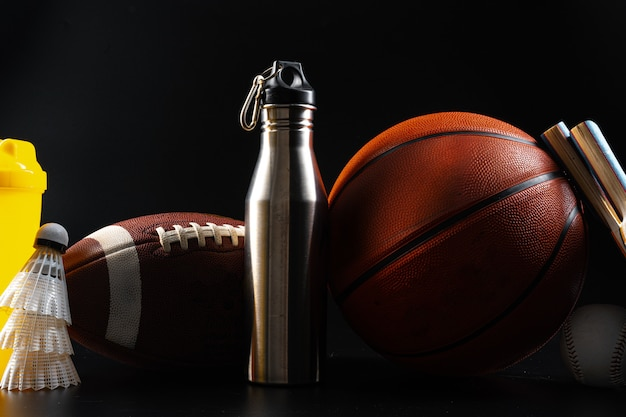 Set of sports equipment and tools on black background close up