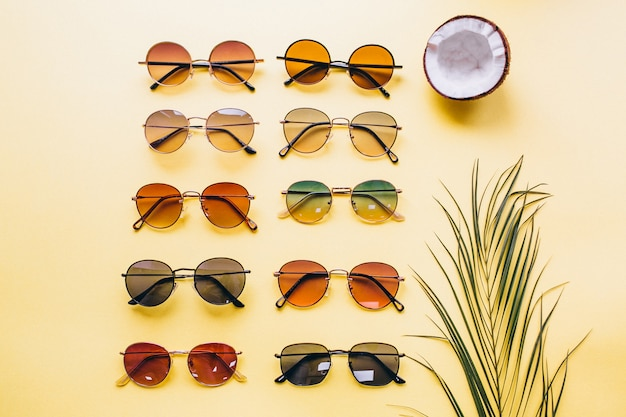 Set of sunglasses on yellow background isolated