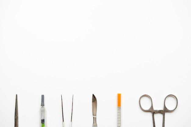 Set of surgery equipment on white table
