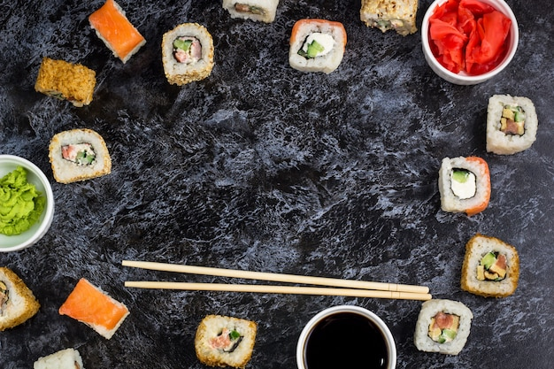 Set of sushi and maki on stone table. top view background copyspace