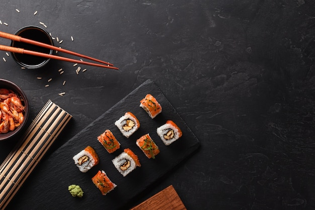 Set of sushi and maki on stone table. top view with copy space