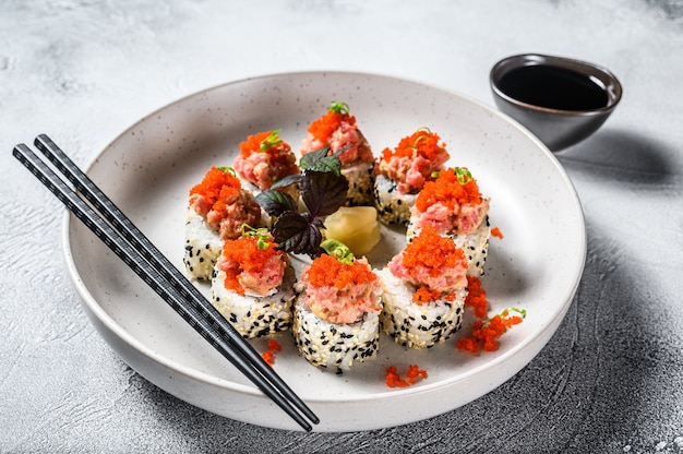 Set sushi roll with avocado, tuna, salmon and caviar