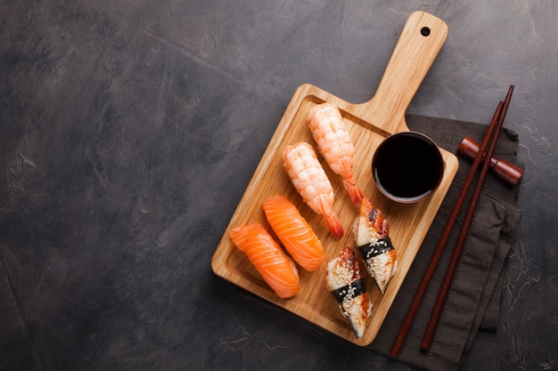 A set of sushi with salmon, shrimp and eel.
