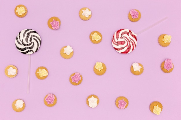 Set of sweets and lollypops on purple background