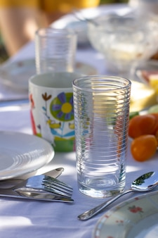 Set table in nature. white tablecloth.outdoor spring or summer casual garden party set up for lunch dinner.