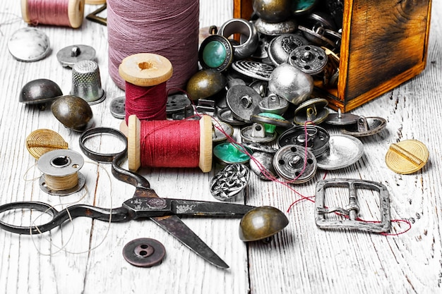 Set of threads,stylish iron buttons and scissors