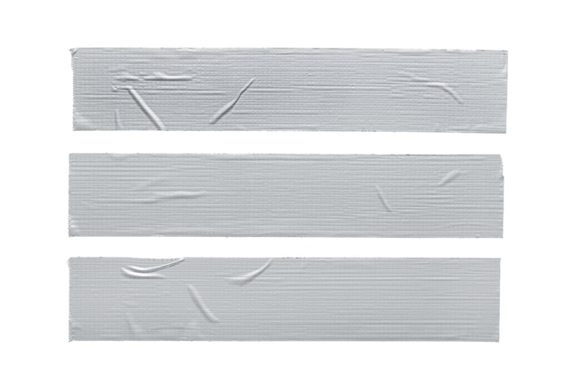 Set of three silver grey repair duct tape pieces isolated on white background.