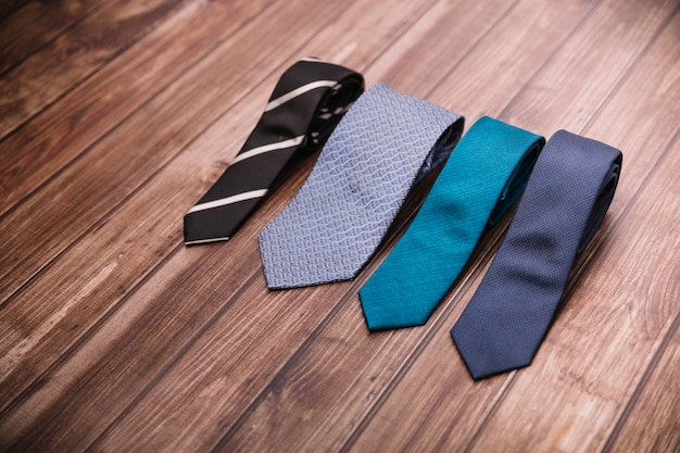 Set of ties on table
