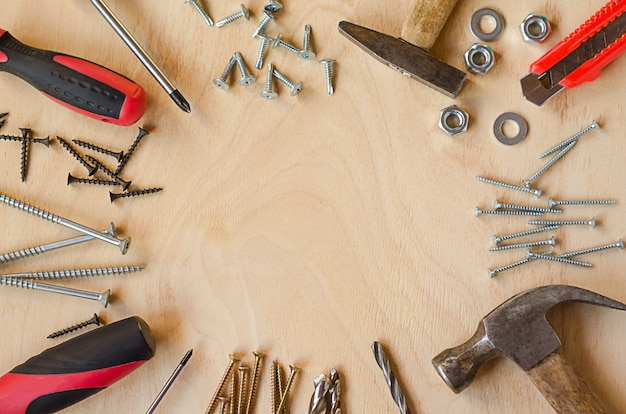 Set of tools for carpenter on wooden background