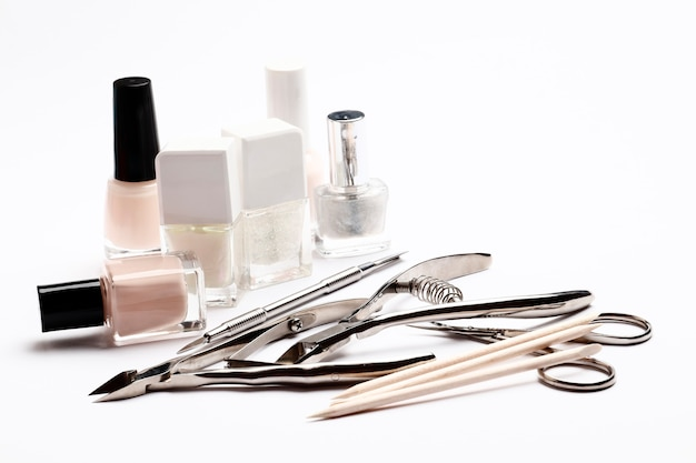 Set of tools for manicure and varnishes isolated on white background. insulation.