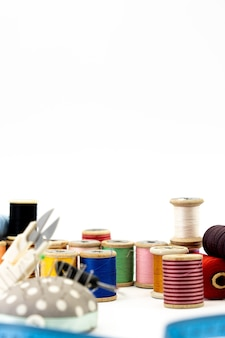 Set of tools for sewing on white background, vertical picture