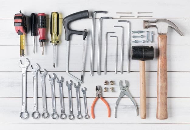 Set of tools supplies on wood background