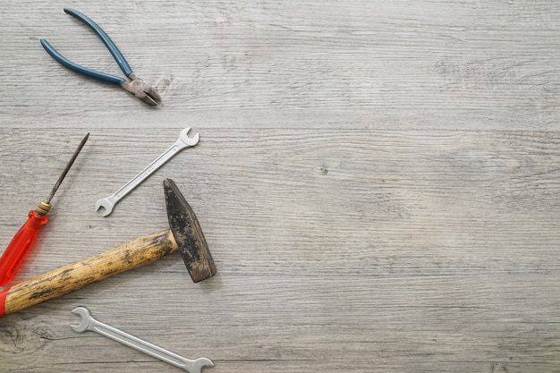 Set of tools on wooden surface