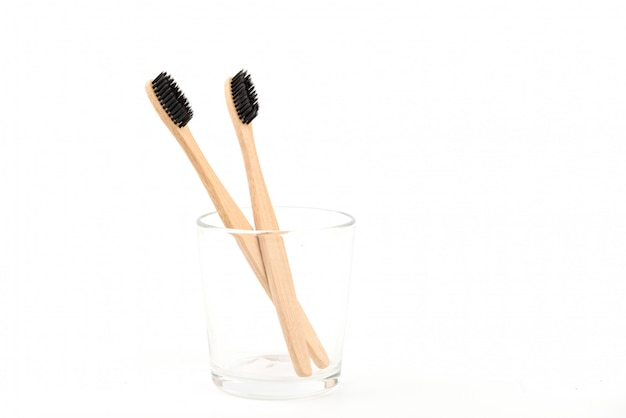 Set of toothbrushes in glass isolated on white background. bamboo eco-friendly. zero waste