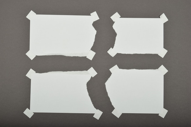 Set of torn ripped paper sheets with stickers isolated on grey background