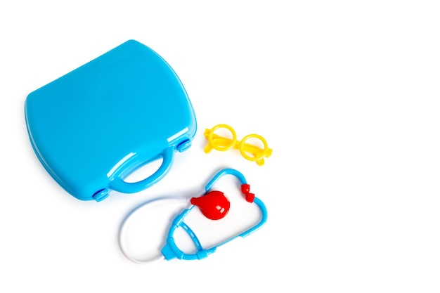 Set of toy medical equipment. medical suitcase. an educational toys for kids on white background.