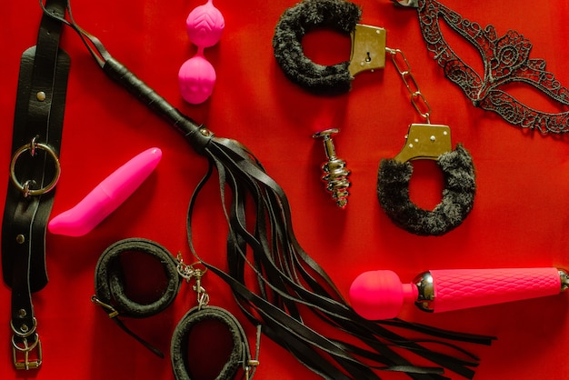 Set of toys for adults: handcuffs, anal plug, mask, whip, vibrator. the view from the top