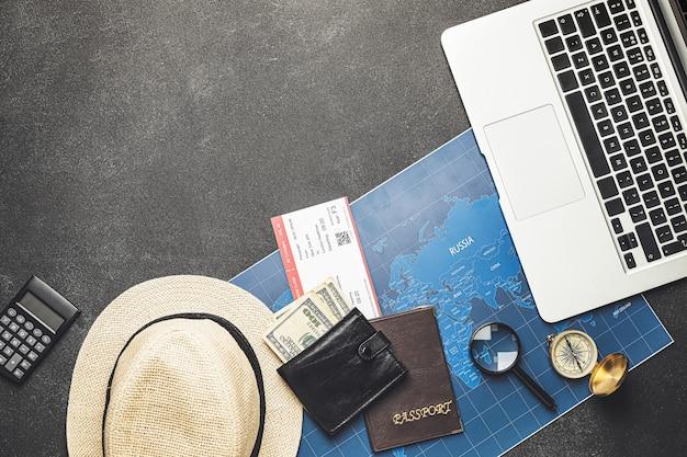 Set of travel items on grey
