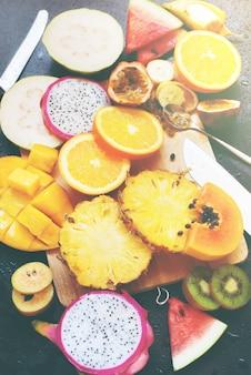Set tropical cut fruits water melon papaya pine