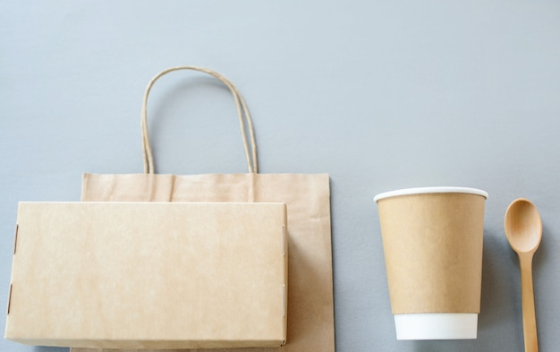 Set of unbleached plant fiber food box and paper coffee cup. natural fiber eco food and drink packaging.