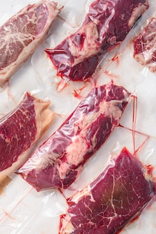 Set of vacuum packed organic raw beef steaks alternative