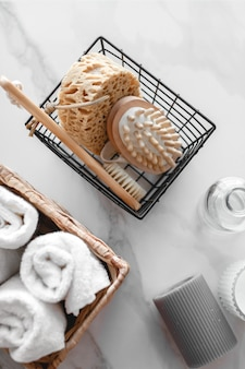 Set of various bath accessories. terry towel, soap, comb, oil, shampoo, loofah washcloth and candles. the view from the top