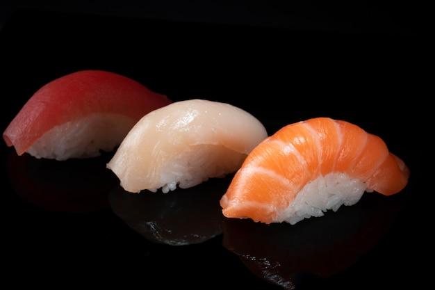 Set of various classic nigiri sushi isolated on black