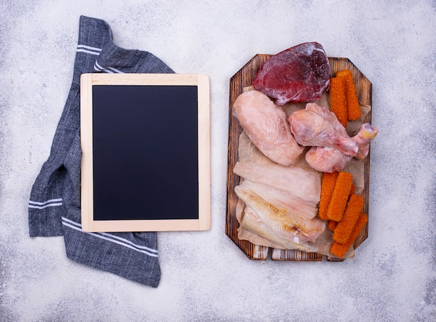 Set of various frozen meat and fish