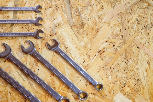 Set of various repair hand tools or auto mechanic's tools. repair tool kit. equipment for building. wooden background, pattern, top view. space for text