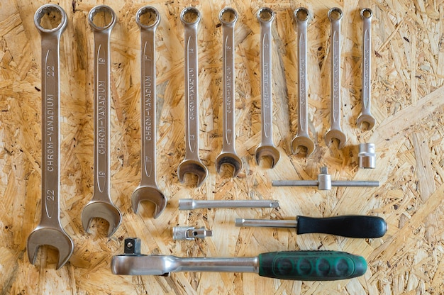 Set of various repair hand tools or auto mechanic's tools. repair tool kit. equipment for building. wooden background, pattern, top view