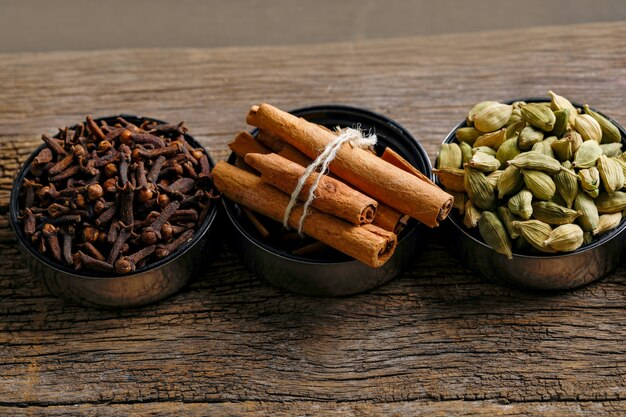Set of various spices on black.