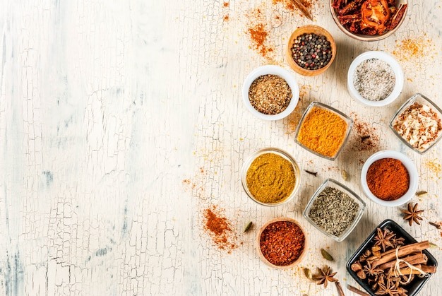 Set of various spices on light concrete background