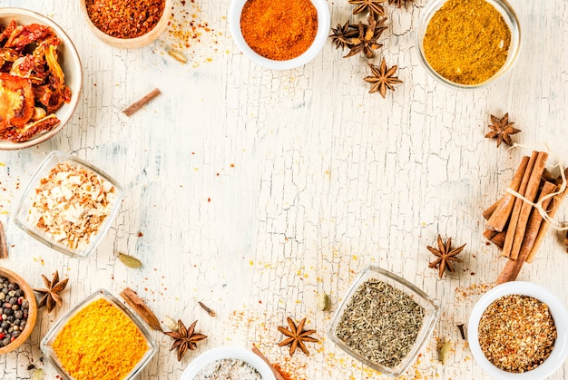 Set of various spices on light concrete .  .