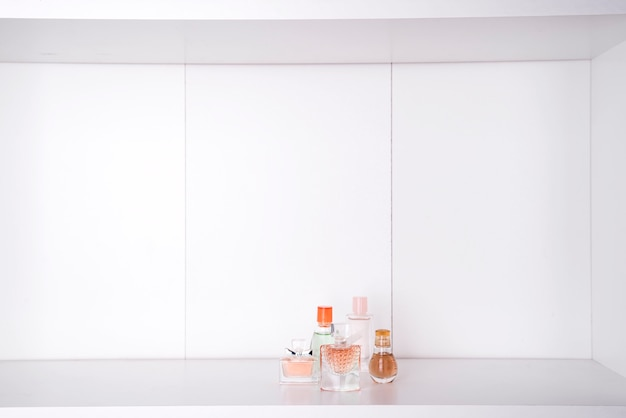 Set of various woman perfumes isolated