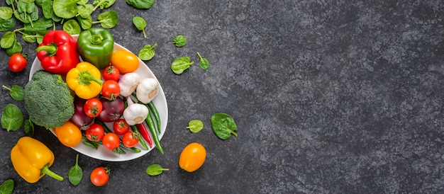 Set of vegetables on a gray background with copyspace.