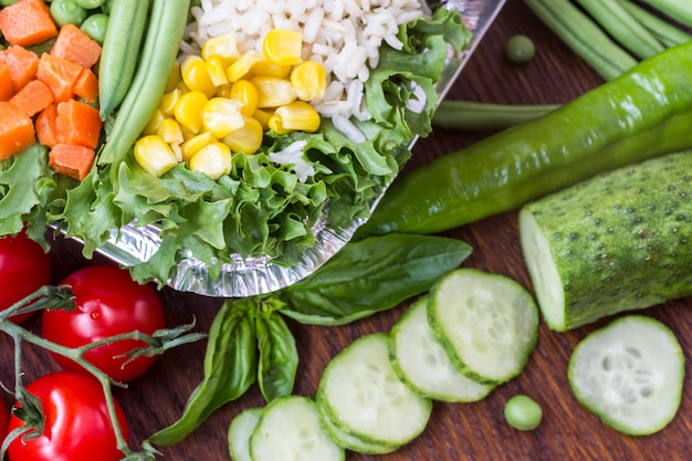 A set of vegetables with rice for a healthy diet: corn, peas, asparagus, carrots, broccoli, lettuce
