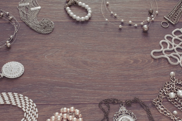 Set of vintage jewelry on a dark wooden background.